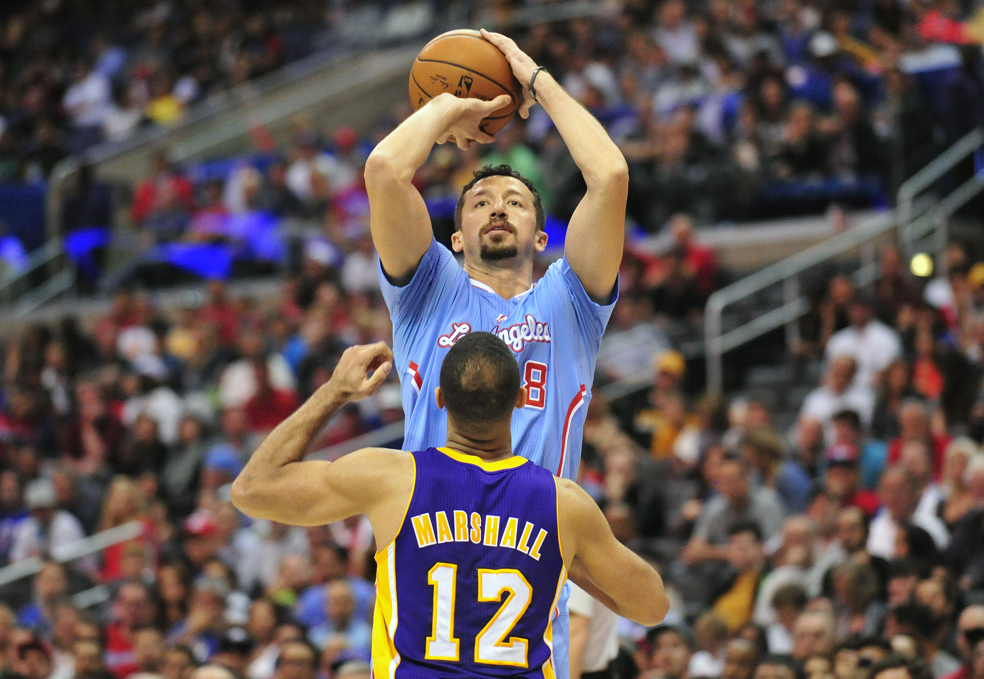Hedo Turkoglu rises over Kendall Marshall for the jumper NBAimages