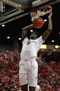 Mar 7, 2015; San Diego, CA, USA; San Diego State Aztecs forward Dwayne Polee II (5) dunks during the second half against the Nevada Wolf Pack at Viejas Arena at Aztec Bowl. Mandatory Credit: Jake Roth-USA TODAY Sports