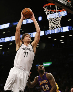 Mar 29, 2015; Brooklyn, NY, USA;  Brooklyn Nets center Brook Lopez (11) goes to the basket against Los Angeles Lakers center Jordan Hill (27) and forward Tarik Black (28) during the second half at Barclays Center. The Brooklyn Nets won 107-99.  Mandatory Credit: Noah K. Murray-USA TODAY Sports