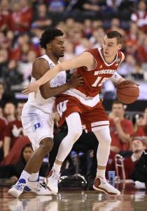 Apr 6, 2015; Indianapolis, IN, USA; Wisconsin Badgers forward Sam Dekker (15) dribbles in the low post defended by Duke Blue Devils forward Justise Winslow (12) during the second half in the 2015 NCAA Men's Division I Championship game at Lucas Oil Stadium. Mandatory Credit: Robert Deutsch-USA TODAY Sports