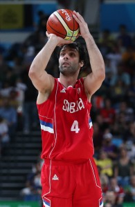 Aug 19, 2016; Rio de Janeiro, Brazil; Serbia point guard Milos Teodosic (4) shoots the ball against Australia power forward Aron Baynes (12) during the men's basketball semifinal in the Rio 2016 Summer Olympic Games at Carioca Arena 1. Mandatory Credit: Jeff Swinger-USA TODAY Sports